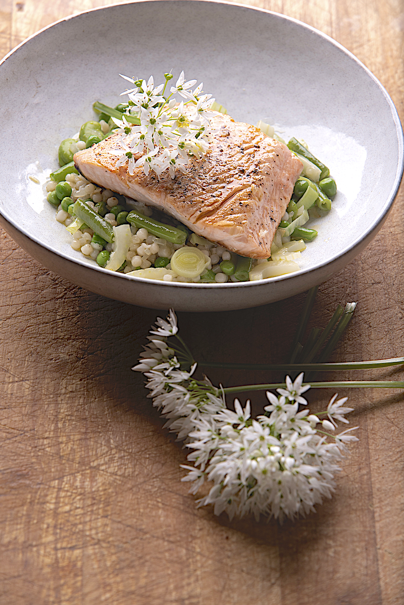 Salmon, warm bean and fregola salad with wild garlic